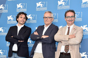 (L-R) Davide Pozzi,Director of L'Immagine Ritrovata Laboratory, Marco Bellocchio, director ,President of Cineteca do Bologna, Gian Luca Farinelli attend the 'La Cina E' Vicina' photocall during the 71st Venice Film Festival on September 3, 2014 in Venice, Italy.