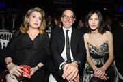 "(L-R) Catherine Deneuve, Nicolas Hieronimus and Alexa Chung attend the ""La French-Art Of Coloring"" - 110th Anniversary of L'Oreal Professional At Carrousel Du Louvre on March 24, 2019 in Paris, France."