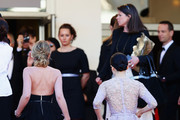 """(L-R) Ludivine Sagnier and Zhang Ziyi arrive at """"Venus In Fur"""" Premiere during the 66th Annual Cannes Film Festival at Grand Theatre Lumiere on May 25, 2013 in Cannes, France."""