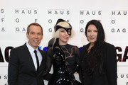 """(L-R) Jeff Koons,  Lady Gaga and Marina Abramovic attend the """"Lady Gaga Presents """"artRave"""" event at Brooklyn Navy Yard on November 10, 2013 in the Brooklyn borough of New York City."""