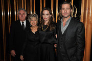 "Angelina Jolie and Brad Pitt pose with Bill Ptt and Jane Pitt at the after party for the premiere of ""In the Land of Blood and Honey"" at the The Standard Hotel Rooftop on December 5, 2011 in New York City."