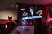 The television at the Billy Goat Tavern plays live the Senate Judiciary Committee hearing on Capitol Hill where professor Christine Blasey Ford and Supreme Court nominee Brett Kavanaugh were testifying on September 27, 2018 in Chicago, Illinois. Ford has accused Kavanaugh of pinning her down and sexually assaulting her when they were both teens.