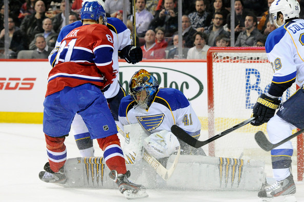Lars Eller Jaroslav Halak #41 of the St. Louis Blues stops the puck in front of Lars Eller #81 of the Montreal Canadiens during the NHL game at the Bell Centre on January 10, 2012 in Montreal, Quebec, Canada.