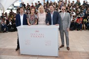 """(FromL) Spanish actor Javier Bardem, French actress Adele Exarchopoulos, South African-US actress Charlize Theron, French actor Jean Reno and British actor Jared Harris pose on May 20, 2016 during a photocall for the film """"The Last Face"""" at the 69th Cannes Film Festival in Cannes, southern France.  / AFP / ALBERTO PIZZOLI"""