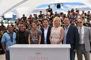 """(FromL) US actor Zubin Cooper, US actor and director Sean Penn, French actress Adele Exarchopoulos, Spanish actor Javier Bardem, South African-US actress Charlize Theron, French actor Jean Reno and British actor Jared Harris pose on May 20, 2016 during a photocall for the film """"The Last Face"""" at the 69th Cannes Film Festival in Cannes, southern France.  / AFP / ALBERTO PIZZOLI"""