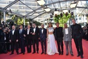 """(FromL) British actor Jared Harris, Spanish actor Javier Bardem, South African-US actress Charlize Theron, French actor Jean Reno, US actor Hopper Penn, French actress Adele Exarchopoulos, US actor and director Sean Penn, US actor Zubin Cooper and US producer Matt Palmieri pose as they arrive on May 20, 2016 for the screening of the film """"The Last Face"""" at the 69th Cannes Film Festival in Cannes, southern France.  / AFP / LOIC VENANCE"""