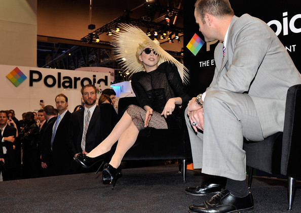 Singer Lady Gaga (L) speaks with John Pollock, chief marketing officer of Polaroid during an announcement of Lady Gaga's long term partnership with Polaroid as the brand's creative director on a specialty line of imaging products at the 2010 International Consumer Electronics Show at the Las Vegas Convention Center January 7, 2010 in Las Vegas, Nevada. CES, the world's largest annual consumer technology tradeshow, runs through January 10 and is expected to feature 2,500 exhibitors showing off their latest products and services to about 110,000 attendees.