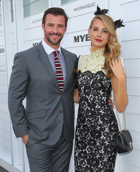 Celebrities Attend Stakes Day [celebrities,kris smith,laura dundovic,clothing,suit,dress,fashion,premiere,formal wear,hairstyle,event,white-collar worker,cocktail dress,myer marquee on stakes day,flemington racecourse,melbourne,australia]