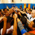 Dieter Zetsche Edwin Moses Photos - Dr. Dieter Zetsche, Chairman of the Board of Management of Daimler AG Head of Mercedes-Benz Cars, takes part in a huddle with students during the Laureus Project Visit at Urban Dove Charter School on November 5, 2015 in Brooklyn, New York. - Laureus Dr. Dieter Zetsche Project Visit
