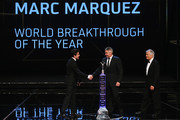Motor cyclist Marc Marquez accepts his Laureus World Breakthrough of the Year award from Laureus Academy members Giacomo Agostini and Mick Doohan  during the 2014 Laureus World Sports Award show at the Istana Budaya Theatre on March 26, 2014 in Kuala Lumpur, Malaysia.