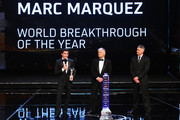 Motor cyclist Marc Marquez speaks with his Laureus World Breakthrough of the Year award from Laureus Academy members Giacomo Agostini and Mick Doohan  during the 2014 Laureus World Sports Award show at the Istana Budaya Theatre on March 26, 2014 in Kuala Lumpur, Malaysia.