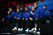 Roger Federer of Team Europe and teammates watch from the courtside in the singles match between Dominic Thiem of Team Europe and Denis Shapovalov of Team World during Day One of the Laver Cup 2019 at Palexpo on September 20, 2019 in Geneva, Switzerland. The Laver Cup will see six players from the rest of the World competing against their counterparts from Europe. Team World is captained by John McEnroe and Team Europe is captained by Bjorn Borg. The tournament runs from September 20-22.