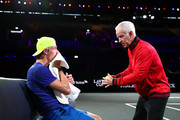John McEnroe, Captain of Team World speaks with Denis Shapovalov of Team World during a practice session ahead of the Laver Cup 2019 at Palexpo on September 19, 2019 in Geneva, Switzerland. The Laver Cup will see six players from the rest of the World competing against their counterparts from Europe. Team World is captained by John McEnroe and Team Europe is captained by Bjorn Borg. The tournament runs from September 20-22.