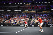 Team World Jack Sock of the United States returns a shot with Team World Kevin Anderson of South Africa against Team Europe Novak Djokovic of Serbia and Team Europe Roger Federer of Switzerland during their Men's Doubles match on day one of the 2018 Laver Cup at the United Center on September 21, 2018 in Chicago, Illinois.