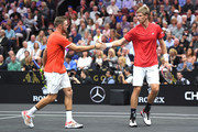 Team World Jack Sock of the United States and Team World Kevin Anderson of South Africa react against Team Europe Roger Federer of Switzerland and Team Europe Novak Djokovic of Serbia during their Men's Doubles match on day one of the 2018 Laver Cup at the United Center on September 21, 2018 in Chicago, Illinois.