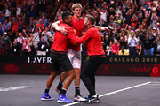 Team World Kevin Anderson of South Africa celebrates with teammates Team World Nick Kyrgios of Australia and Team World Jack Sock of the United States after defeating Team Europe Novak Djokovic of Serbia in his Men's Singles match on day two of the 2018 Laver Cup at the United Center on September 22, 2018 in Chicago, Illinois.