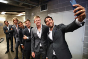 R-L Jeremy Chardy of Team Europe takes a selfie of team mates Kyle Edmund, David Goffin,Grigor Dimitrov,Alexander Zverev and Roger Federer as Team Europe wait backstage to be unveiled at the official welcome ceremony prior to the Laver Cup at the United Center on September 19, 2018 in Chicago, Illinois.The Laver Cup consists of six players from the rest of the World competing against their counterparts from Europe.John McEnroe will captain the Rest of the World team and Europe will be captained by Bjorn Borg. The event runs from 21-23 Sept.