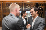 Team Europe members Roger Federer of Switzerland greets Kyle Edmund of England prior to the Team Ceremony on September 19, 2018 in Chicago, Illinois. The Laver Cup consists of six players from the Rest of the World competing against their counterparts from Team Europe.  John McEnroe will captain the Rest of the World Team and Team Europe will be captained by Bjorn Borg.  The event runs from Sept.21-23.