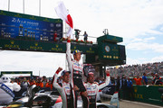 The Toyota Gazoo Racing TS050 Hybrid team of (L-R) Sebastien Buemi,  Kazuki Nakajima and Fernando Alonso celebrate after Toyota win for the first time at the Le Mans 24 Hour race at the Circuit de la Sarthe on June 17, 2018 in Le Mans, France.