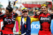 (L-R) George Hincapie, Cadel Evans and Marcus Burghardt of team BMC signs take part in a victory parade after winning the 2011 Tour de France after the twenty first and final stage of Le Tour de France 2011, from Creteil to the Champs-Elysees in Paris on July 24, 2011 in Paris, France.