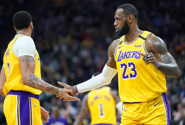 Los Angeles Lakers v Sacramento Kings [player,sports,basketball player,team sport,ball game,sport venue,jersey,product,tournament,sports equipment,lebron james 23,user,anthony davis,hands,note,los angeles lakers,sacramento kings,team,basketball game,half,los angeles lakers,lebron james,nba,sacramento kings,portland trail blazers,san antonio spurs,the nba finals,phoenix suns,basketball]