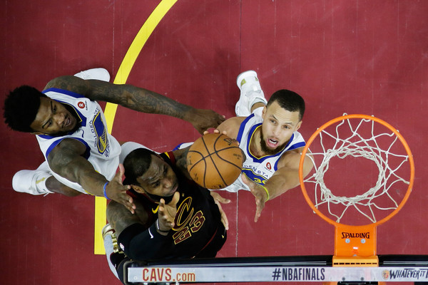 2018 NBA Finals - Game Three [photograph,sports,basketball player,basketball,basketball moves,team sport,player,ball game,sports equipment,lebron james,user,user,stephen curry,game,note,nba,cleveland cavaliers,finals]