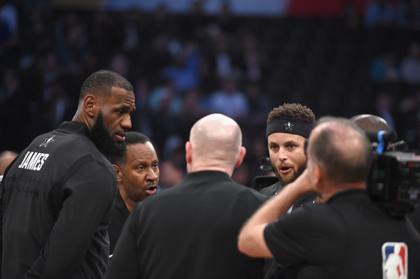 NBA All-Star Game 2018 [product,championship,referee,competition event,arm,event,sport venue,muscle,coach,contact sport,lebron james 23 of team lebron,team stephen,stephen curry,staples center,california,los angeles,center court,l,nba all-star game]