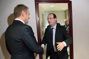 Polish Prime Minister Donald Tusk (L) and French President  Francois Hollande meet at the EU Headquarters during the on the first day of a two-day European Union leaders summit on February 7, 2013 in Brussels, Belgium, European Union leaders are set to duscuss the EU's budget.