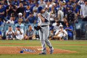 Jon Lester #34 of the Chicago Cubs reacts in the fifth inning against the Los Angeles Dodgers during game two of the National League Championship Series at Dodger Stadium on October 15, 2017 in Los Angeles, California.