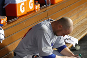 Jon Lester #34 of the Chicago Cubs sits in the dugout after pitching during the fifth inning against the Los Angeles Dodgers in Game Two of the National League Championship Series at Dodger Stadium on October 15, 2017 in Los Angeles, California.