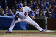 Anthony Rizzo #44 of the Chicago Cubs receives a throw at first base in the sixth inning against the Los Angeles Dodgers during game three of the National League Championship Series at Wrigley Field on October 17, 2017 in Chicago, Illinois.