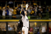 Ryan Braun #8 of the Milwaukee Brewers celebrates after hitting an RBI double to score Christian Yelich #22 against Hyun-Jin Ryu #99 of the Los Angeles Dodgers during the second inning in Game Six of the National League Championship Series at Miller Park on October 19, 2018 in Milwaukee, Wisconsin.
