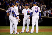 Kris Bryant #17, Addison Russell #27, Javier Baez #9, and Anthony Rizzo #44 of the Chicago Cubs meet during a pitching change in the seventh inning against the Los Angeles Dodgers during game four of the National League Championship Series at Wrigley Field on October 18, 2017 in Chicago, Illinois.