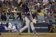 Ryan Braun #8 of the Milwaukee Brewers singles to left field during the 12th inning of Game Four of the National League Championship Series against the Los Angeles Dodgers at Dodger Stadium on October 16, 2018 in Los Angeles, California.
