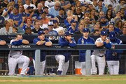 (L-R) Max Muncy #13, Chase Utley #26, Clayton Kershaw #22, Ross Stripling and Cody Bellinger #35 of the Los Angeles Dodgers look on from the dugout during the seventh inning of Game Three of the National League Championship Series against the Milwaukee Brewers at Dodger Stadium on October 15, 2018 in Los Angeles, California. The Brewers defeated the Dodgers 4-0.