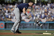 Ryan Braun #8 of the Milwaukee Brewers tosses aside his foot guard after stirking out swinging to end the first inning during Game Five of the National League Championship Series against the Los Angeles Dodgers at Dodger Stadium on October 17, 2018 in Los Angeles, California.