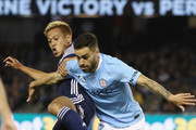 Anthony Caceres of Melbourne City is challenged by Keisuke Honda of the Victory during the round one A-League match between Melbourne Victory and Melbourne City at Marvel Stadium on October 20, 2018 in Melbourne, Australia.