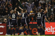 Keisuke Honda of the Victory celebrates with teammates after scoring a goal during the round one A-League match between Melbourne Victory and Melbourne City at Marvel Stadium on October 20, 2018 in Melbourne, Australia.