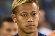 Keisuke Honda of the Victory  walks out onto the field during the round one A-League match between Melbourne Victory and Melbourne City at Marvel Stadium on October 20, 2018 in Melbourne, Australia.