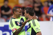 Harry Kewell of the Victory celebrates with team mate Archie Thompson after scoring a goal during the round 13 A-League match between the Brisbane Roar and the Melbourne Victory at Suncorp Stadium on December 31, 2011 in Brisbane, Australia.