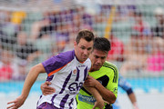 Shane Smeltz (L) of the Glory is challenged by Rodrigo Vargas (R) of the Victory at nib Stadium on January 22, 2012 in Perth, Australia.
