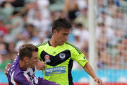 Shane Smeltz of the Glory tackles Rodrigo Vargas of the Victory  in the game betwenn Perth Glory and Melbourne Victory  at nib Stadium on January 22, 2012 in Perth, Australia.