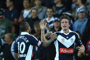 Harry Kewell of the Victory celebrates his goal with Archie Thompson during the round 19 A-League match between the Melbourne Victory and the Central Coast Mariners at AAMI Park on February 10, 2012 in Melbourne, Australia.