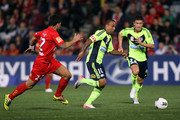 Archie Thompson of the Victory runs with the ball during the round two A-League match between Adelaide United and Melbourne Victory at Hindmarsh Stadium on October 14, 2011 in Adelaide, Australia.