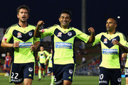 Carlos Hernandez (C), Harry Kewell (L) and Archie Thompson (R) of the Victory celebrate after Hernandez scored his teams first goal during the round nine A-League match between the Newcastle Jets and the Melbourne Victory at Ausgrid Stadium on December 3, 2011 in Newcastle, Australia.