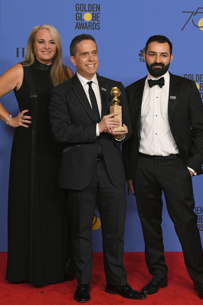 75th Annual Golden Globe Awards - Press Room [best motion picture,suit,event,award,carpet,premiere,formal wear,tuxedo,red carpet,award ceremony,flooring,darla k. anderson,lee unkrich,adrian molina,coco,l-r,room,press room,the beverly hilton hotel,golden globe awards]