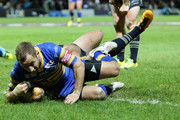 Rob Burrow (C) of Leeds Rhinos crosses over to score his teams first try during the World Club Series match between Leeds Rhinos and North Queensland Cowboys, at Headingley Carnegie Stadium, on February 21, 2016 in Leeds, England.