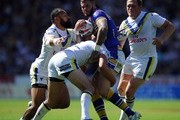 Zak Hardaker of Leeds Rhinos is tackled by Stefan Ratchford and Roy Asotasi of Warrington Wolves during the Tetley's Challenge Cup Semi Final match between Leeds Rhinos and Warrington Wolves at Langtree Park on August 09, 2014 in St Helens, England.