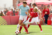 """Diego Forlan (C) and Marina Fedorova in action  during the Legends Football Match in """"The park of Soccer and rest"""" at Red Square on July 11, 2018 in Moscow, Russia."""