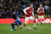 Aaron Ramsey of Arsenal takes the ball past Hamza Choudhury of Leicester City during the Premier League match between Leicester City and Arsenal at The King Power Stadium on May 9, 2018 in Leicester, England.